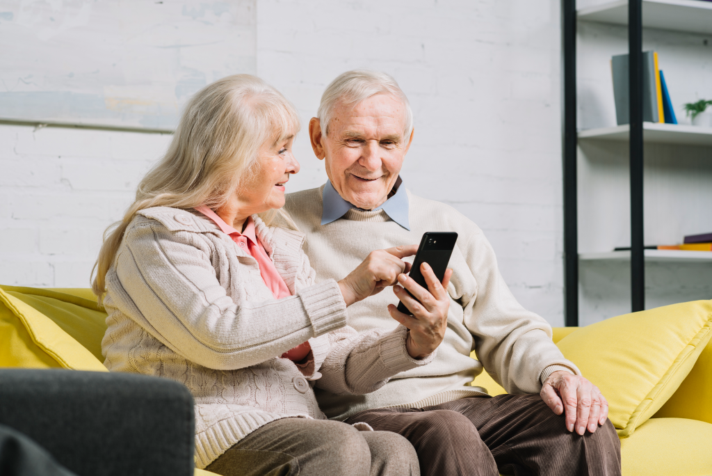 elders using mobile phone
